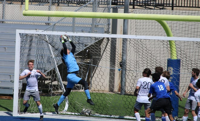 Shawnee goalkeeper George Coons snags the ball off a corner kick this past weekend during the Rose Rock Tournament in Noble.
