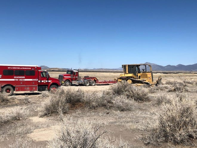 CAL FIRE works to contain the Refuge Fire near Tulelake on Sunday, March 28, 2021.