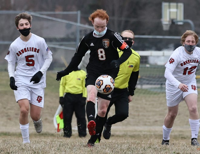 Kewanee's Kaden Peterson (8) is bracketed by two LaSalle-Peru players on Wednesday.