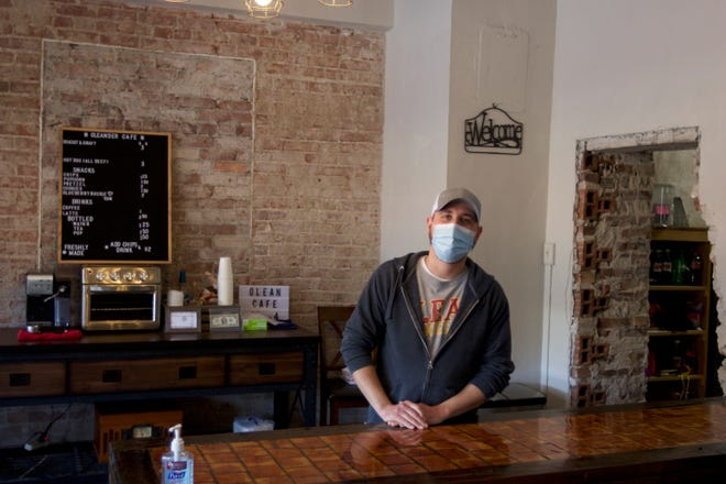Zach Stanek, owner of Oleander Cafe, stands behind the counter of his new eatery. The cafe, located inside of Topeka Vendors Market is known for serving New York-inspired dishes.