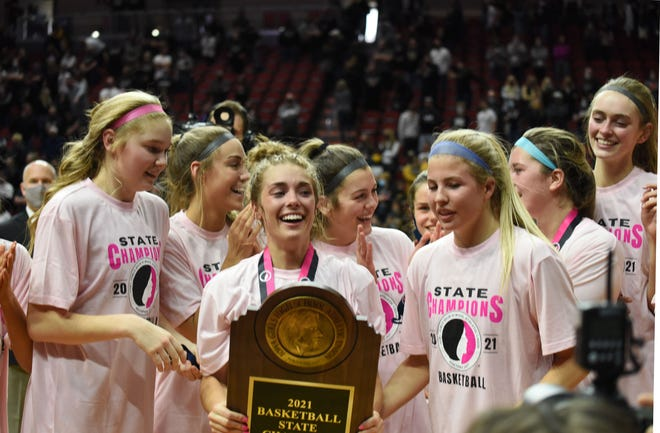 Molly Ihle (with trophy) and Josie Fleischmann (front right) led the Ballard girls' basketball team to the Class 4A state championship in 2020-2021. The Bombers went 24-1 to claim the second state title in school history.