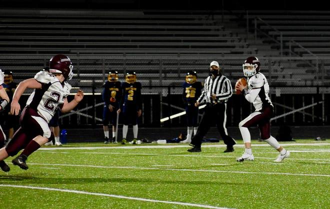 Quaboag quarterback Derrick Shepherd looks for an open receiver during a recent game.
