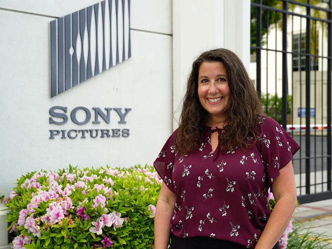 """Worcester native Andrea Ajemian in front of Sony Pictures. Ajemian is the executive producer/unit production manager for the Sony Pictures/Screen Gems' horror flick """"The Unholy,"""" which opens Friday nationwide."""
