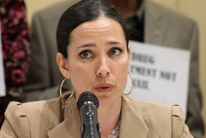 Sen. Sonia Chang-Diaz of Boston, pictured speaking at a criminal justice reform event in 2018, has served 12 years in the Senate and is now considering a run for governor.