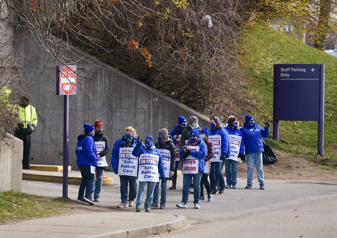 Striking nurses near the staff entrance of St. Vincent Hospital in Worcester on Monday.