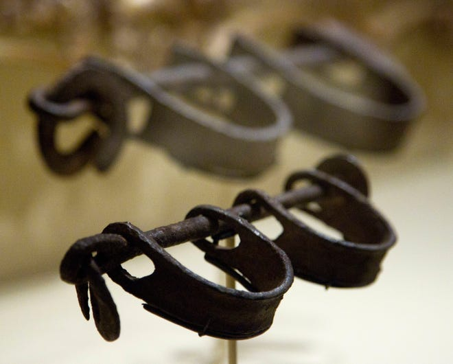 Nineteenth century shackles, typically found on slave ships, are displayed at the Smithsonian's National Museum of American History in Washington in 2012.