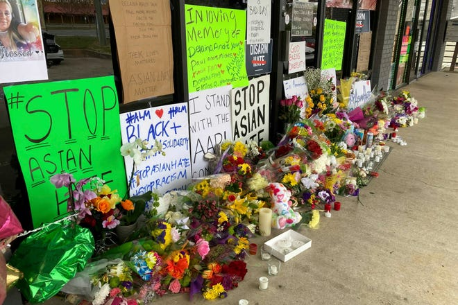 A make-shift memorial is seen in Acworth, Ga., in the aftermath of eight people being killed Tuesday in shootings at three metro Atlanta-area massage businesses.