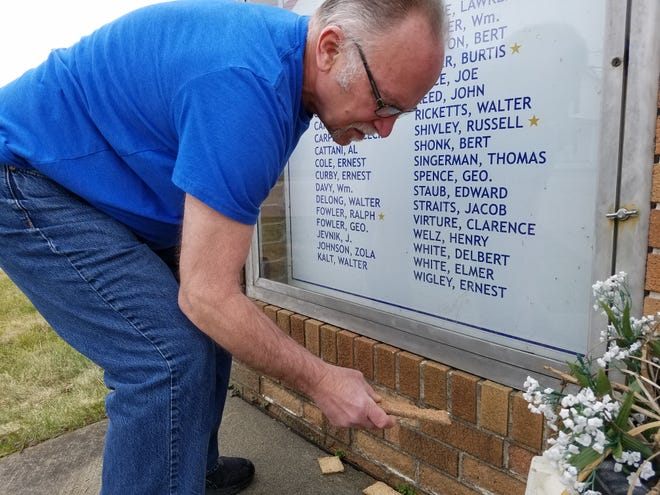 Midvale Mayor Larry Kopp shows spalled brick on the village's war memorial. Repairs to the brick are among the items to be funded by a 0.5% income tax increase being sought by village government in the May 4 primary election.