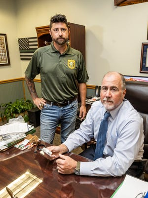 Bay County Sheriff's Office Lt. Kevin Francis and Sheriff Tommy Ford discuss the use of NARCAN nasal spray to combat drug overdoses on March 29. Bay County plans to use money from a federal opioid lawsuit settlement to help combat addiction.