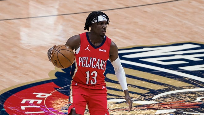 New Orleans Pelicans guard Kira Lewis Jr. (13) against the Dallas Mavericks in the third quarter of an NBA basketball game in New Orleans, Saturday, March 27, 2021. (AP Photo/Derick Hingle)