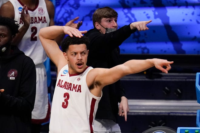 Alabama forward Alex Reese (3) reacts to a play against UCLA in the first half of a Sweet 16 game in the NCAA men's college basketball tournament at Hinkle Fieldhouse in Indianapolis, Sunday, March 28, 2021. (AP Photo/Michael Conroy)