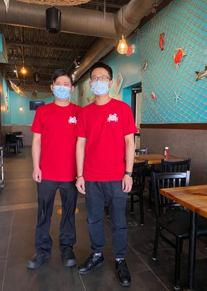 Brothers Eddie (left) and Kai Jiang have opened Two Claws, a Cajun-style seafood restaurant, at 599 S. State St. in Westerville.