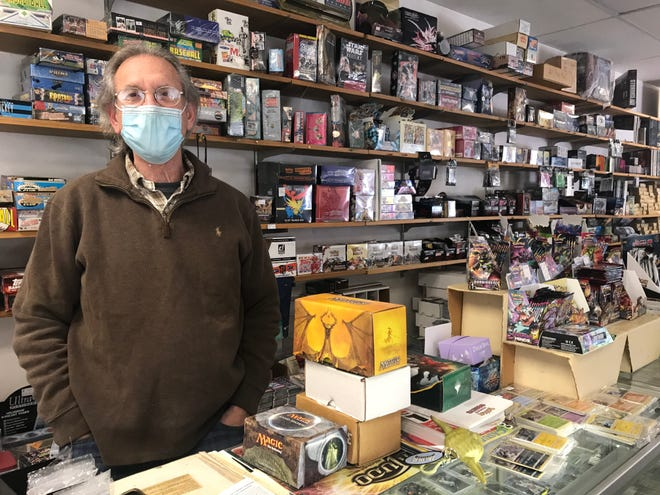 Dan Ferullo behind the counter of Hit & Run. Ferullo ran the shop for 28 years, cultivating a loyal customer base of card-collecting enthusiasts.
