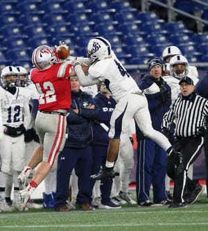 Left in single coverage with the state's best player in the Prep's 2019 Super Bowl victory over Catholic Memorial, Eagles' defensive back Matthew Mitchell (4) held down BC-bound Owen McGowan (46). Above, the Medford native breaks up a pass intended for McGowan on a sideline route.