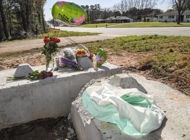 Flowers and a balloon are left at the site of a fatal accident on State Highway 24, one-mile West of the Anderson Regional Airport, Monday, March 29, 2021.