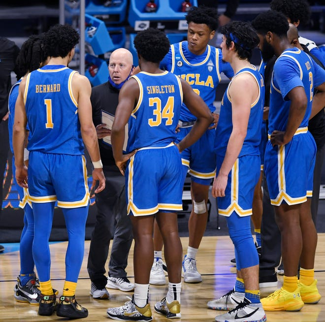 UCLA coach Mick Cronin talks with his team during the Sweet 16 round of the 2021 NCAA Tournament on Sunday, March 28, 2021, at Hinkle Fieldhouse in Indianapolis.
