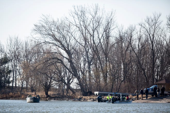 Law enforcement search for a missing Iowa State University Crew Club member on Monday, March 29, 2021, at Little Wall Lake in Iowa.