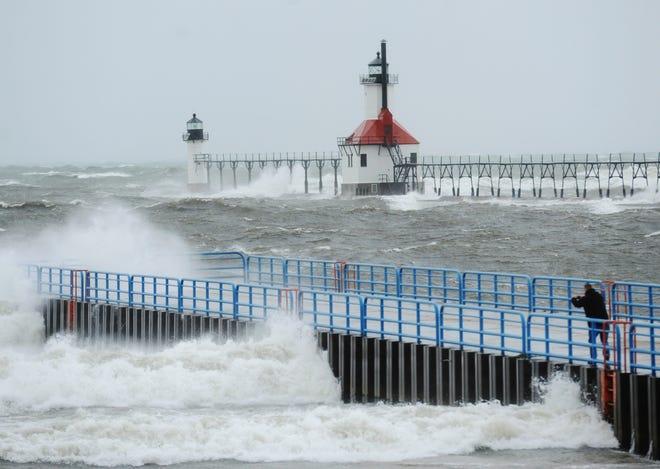 Lake Michigan waves crash into the north and south piers Saturday, Nov. 19, 2016, in St. Joseph, Mich.