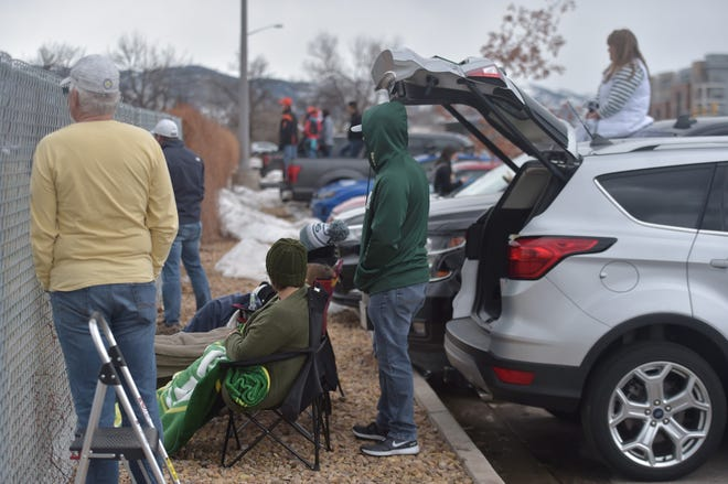 Spectators watch a Colorado State women's soccer match against Air Force through the fencing around the field Friday, March 26, 2021. The university is not allowing spectators inside its facilities for any sports events this spring, the Pandemic Preparedness Team said.