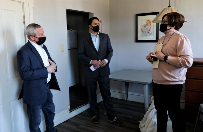 Susan Nixon Stoughton, far right, leads Ohio Rep. Jeff LaRe and Ohio Secretary of State Frank LaRose on a tour through The Lighthouse in Lancaster on Monday, March 29.