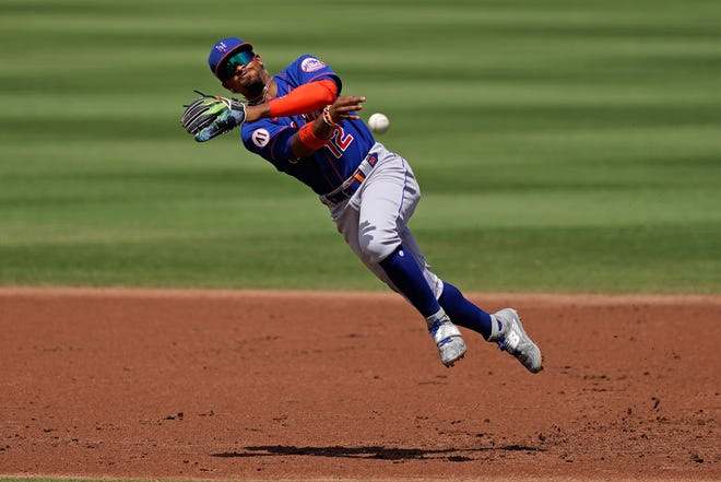Mar 28, 2021; Jupiter, Florida, USA; New York Mets shortstop Francisco Lindor (12) throws out Miami Marlins center fielder Starling Marte (6, not pictured) in the 2nd inning of the spring training game at Roger Dean Chevrolet Stadium. Mandatory Credit: Jasen Vinlove-USA TODAY Sports