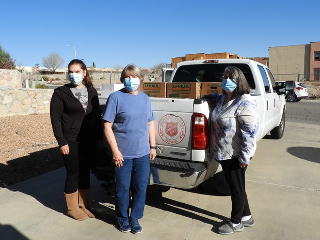 Pictured from left to right are Vanessa, Jeanne Libby and Judy Paulis load family food boxes on Friday, March 26 through a partnership with the Las Cruces P.E.O. Chapter 1 and the Salvation Army.
