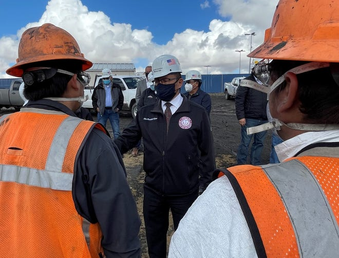 Navajo Nation Vice President Myron Lizer, center, received an update about the Community Heating Resource Program during a visit to Navajo Mine on March 26.