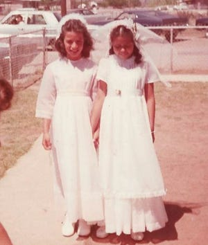 """Diana Almader-Douglas and """"Jane Doe"""" stand outside of St. Bernard Catholic Church in Pirtleville, Arizona, at their first communion. Almader-Douglas came forward in 2019 and said she was sexually abused by Father Charles Knapp, a full-time retired priest with the Diocese of Tucson."""