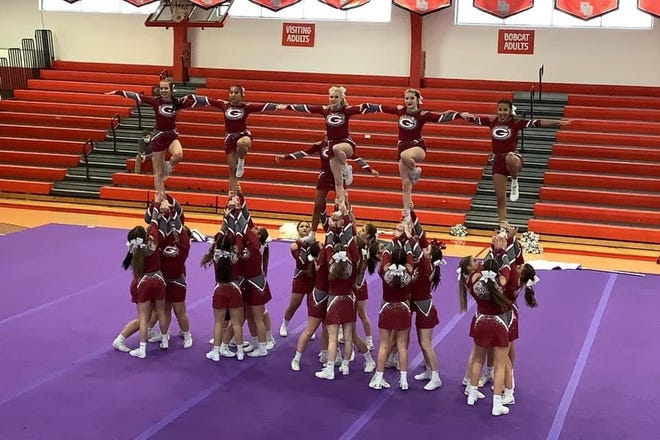 Genoa cheer finished first at state in two divisions.