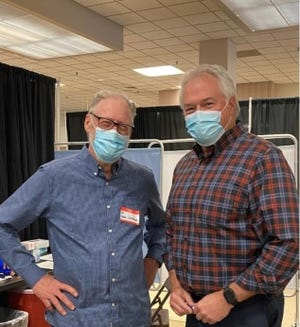 Dr. David Jetmore and Dr. Brad Barrett, the state representative for District 56, vaccinated Wayne County residents Saturday during a vaccination clinic inside the former Elder-Beerman building.
