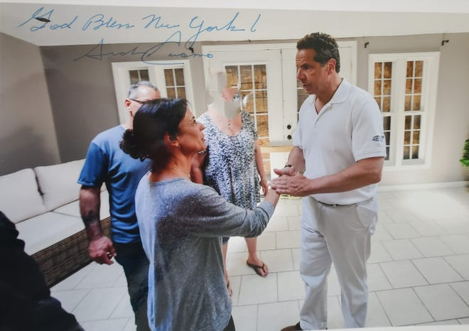 Sherry Vill, 55, of Greece, Monroe County, shared a photo of her with Gov. Andrew Cuomo during a visit to her home in 2017 after he toured flooding in her neighborhood. Vill claims Cuomo later aggressively kissed her on the cheek on two separate incidents during the visit.