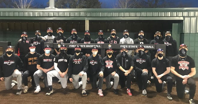 The 2021 Brandon Valley high school team poses for a photo prior to their five-game swing through Kansas in late March.