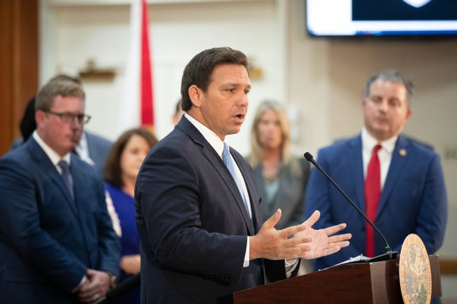 Gov. Ron DeSantis speaks during a press conference in the Cabinet meeting room at the Capitol on March 29.