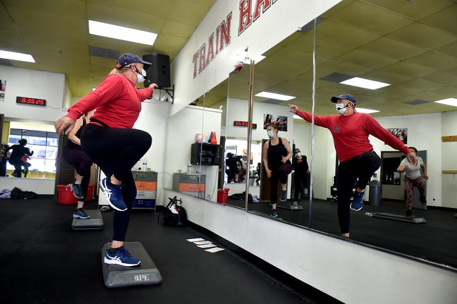 Vanessa White, owner of Santa Paula Fitness, leads an exercise class on Monday, March 29, 2021.