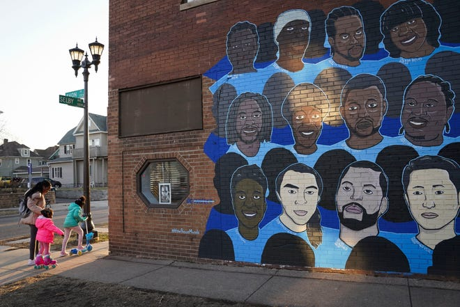 A mural in Minneapolis displaying various people who have died while in police custody.