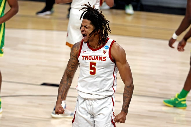 USC guard Isaiah White reacts to a play during the first half of the Trojans' Sweet 16 game against Oregon.