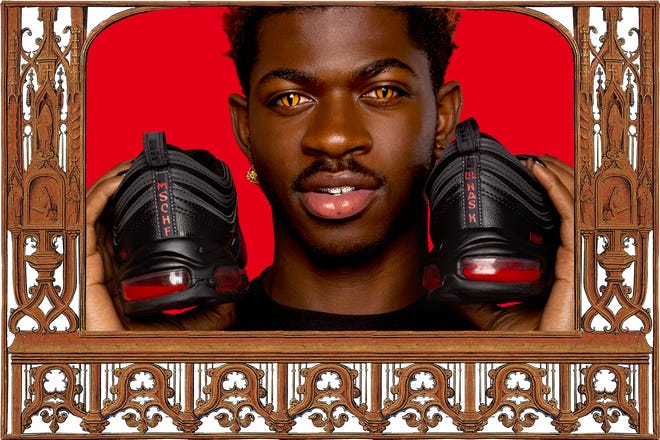 Lil Nas X shows off the Satan Shoes which went on sale Monday.