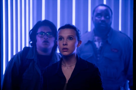 """Madison Russell (Millie Bobby Brown, center, with Julian Dennison and Brian Tyree Henry) leads the charge to help her pal Godzilla in """"Godzilla vs. Kong."""""""