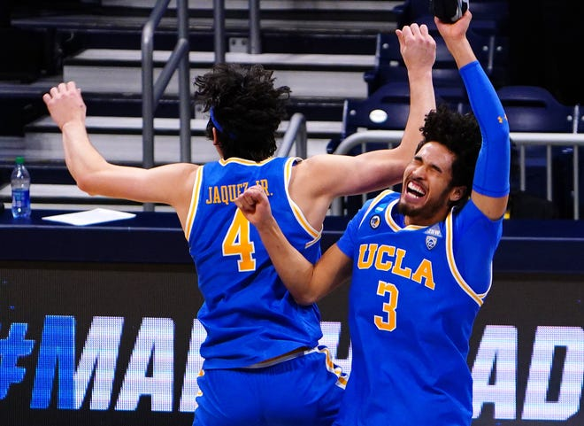 UCLA's Jaime Jaquez Jr. (4) and Johnny Juzang celebrate their Sweet 16 win over Alabama.