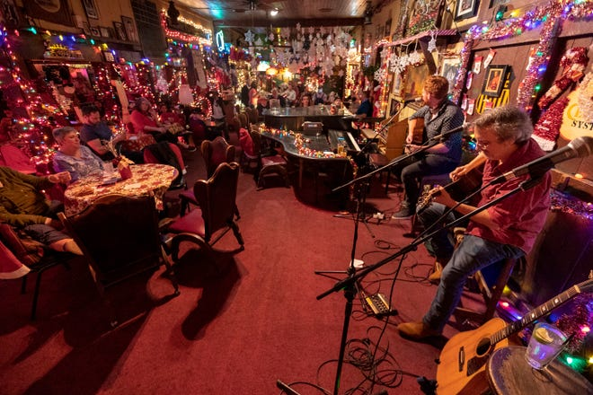 Pat Byrne, left, and Rich Brotherton perform Monday, March 29, at Donn's Depot. The popular local bar opened over the weekend after being closed for more than a year.