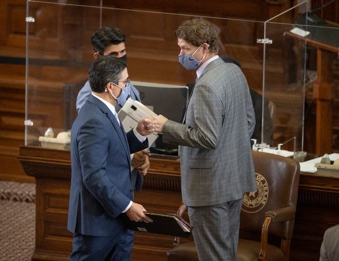 State Rep. Chris Paddie, R-Marshall, left, gets a fist bump from state Rep. Matt Krause, R-Fort Worth, after his House Bill 11, addressing the widespread power outages last month, passed on Tuesday.