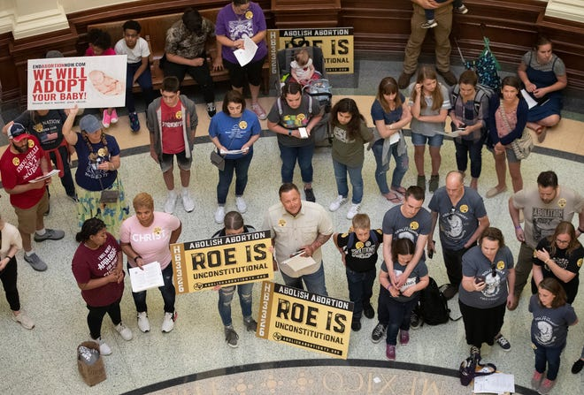 Abortion abolition protesters gather Tuesday in the Capitol Rotunda after the Texas Senate approved six measures to restrict the procedure. The protesters were at the legislature in support of House Bill 3326, which would prohibit abortion.