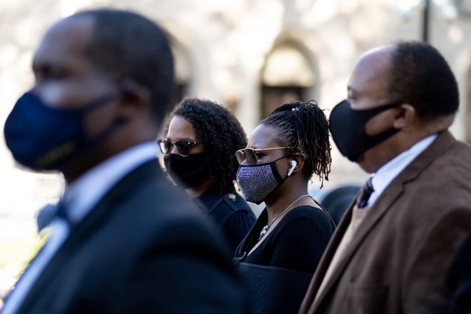 Georgia state Rep. Park Cannon, D-Atlanta,, center, walks beside Martin Luther King III as she returns to the Capitol in Atlanta on Monday morning, March 29, 2021, after being arrested last week for knocking on the governor's office door as he signed voting legislation. (AP Photo/Ben Gray)