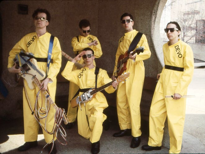 The Akron band Devo, from left, Mark Mothersbaugh, Bob Mothersbaugh, kneeling, Jerry Casale, Bob Casale  and Alan Myers, pose for a photo in 1978.