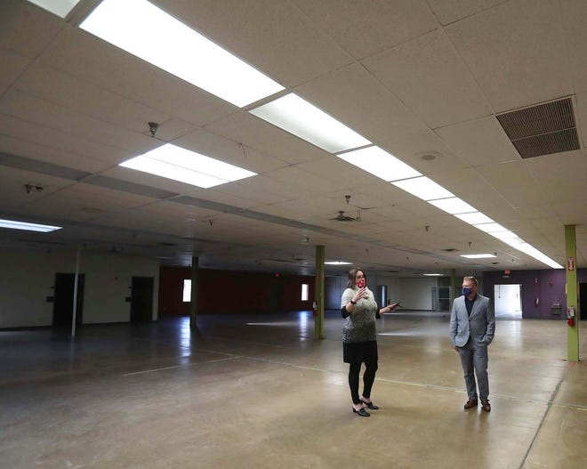 Lori L. Pesci, left, deputy director of the Division of Public Safety for the Summit County Executive's Office, and Justin Fye, project architect for Mann Parsons Gray Architects, walk through the former site of the Weaver Workshop that will become the new regional dispatch center.