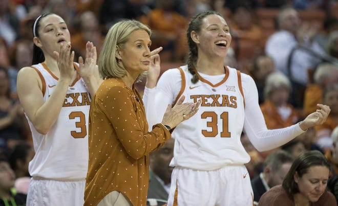 Texas guard Danni Williams (3) and Audrey Warren (31) celebrate a score with head coach Karen Aston during a game against UTSA at the Erwin Center in Austin on Nov. 28, 2018. Aston has been hired to coach the Roadrunners.