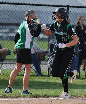 West Branch's Jordan Anderson is congratulated by coach Sis Woods after hitting a home run in an Eastern Buckeye Conference game against Alliance at West Branch High School Tuesday, March 30, 2021.