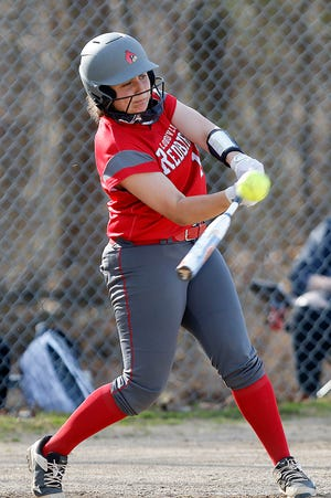 Loudonville's Libby England (12) connects with a pitch during the Redbirds' 19-5 win over South Central Tuesday at South Central High School.