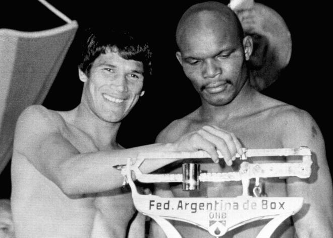 Augusta-born Bennie Briscoe (right) is seen with world champ Carlos Monzon during a weigh-in before a 1972 title fight. Briscoe never won a world title, but he became a favorite of many boxing fans in Philadelphia.