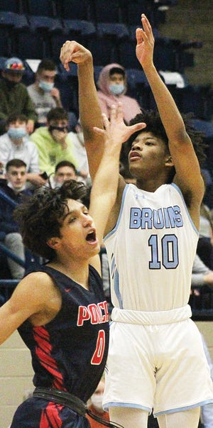 Bartlesville High's David Castillo, right, lets a shot fly over a defender during varsity basketball action last season. The freshman Castillo received two scholarship offers, from Tulsa and Oklahoma State, during March. He also was selected to try out for the USA Basketball 16-and-under team.